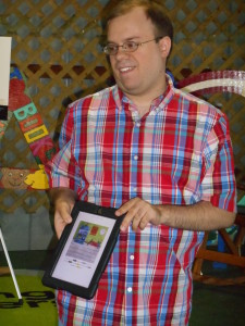Reading to the children at the Oswego County Fair.