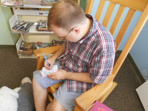 Signing the children's autograph books at the Oswego City Public Library.